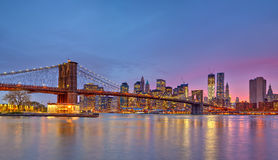 Brooklyn bridge and Manhattan at dusk Stock Photo