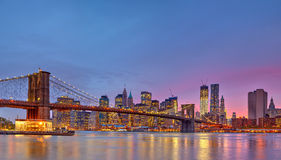 Brooklyn bridge and Manhattan at dusk. New York City Royalty Free Stock Images