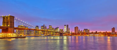Brooklyn bridge and Manhattan at dusk Stock Images