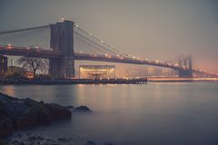Brooklyn bridge at foggy evening Stock Images