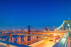 Brooklyn Bridge and Manhattan with lights and reflections. New Y Royalty Free Stock Images