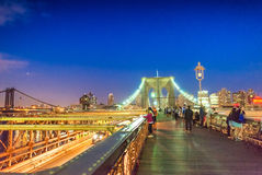 Brooklyn Bridge and Manhattan with lights and reflections. New Y Royalty Free Stock Photos