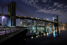 Brooklyn Bridge . Manhattan. New York. United States of America. Towers on Manhattan's Island on the night. New York City royalty free stock image