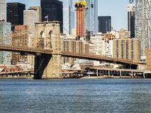Brooklyn Bridge with Manhattan skyline background from Brooklyn early in the morning with blue sky and sun shine Royalty Free Stock Photography