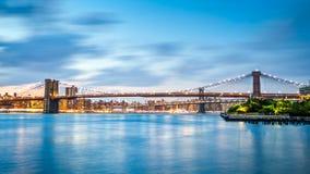 Brooklyn Bridge and Manhattan skyline at dusk Stock Images