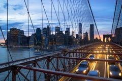 Brooklyn Bridge and Manhattan. The Brooklyn Bridge and skyline of New York City at sunset Stock Images