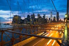 Brooklyn Bridge and Manhattan. The Brooklyn Bridge and skyline of New York City at sunset Stock Image