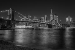 The Brooklyn Bridge and Manhattan skyline at night, from DUMBO, Brooklyn, New York City.  royalty free stock images