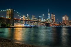The Brooklyn Bridge and Manhattan skyline at night, from DUMBO, Brooklyn, New York City.  royalty free stock photo