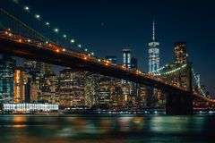 The Brooklyn Bridge and Manhattan skyline at night, from DUMBO, Brooklyn, New York City.  royalty free stock photos