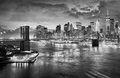 Brooklyn Bridge and Manhattan skyline at night, New York. Black and white picture of the Brooklyn Bridge and Manhattan skyline at night, New York City, USA Royalty Free Stock Images
