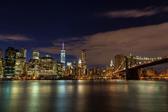 Brooklyn Bridge on Manhattan skyline at night in New York City. Iconic view of the New York skyline stock image