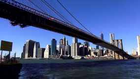 Brooklyn Bridge and Manhattan Skyline on a sunny day USA cityscapes stock video footage