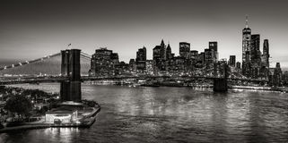 Brooklyn Bridge and Manhattan skyscrapers at twilight in Black & White. New York City. Black & White elevated view of the Brooklyn Bridge and Lower Manhattan royalty free stock images