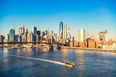 Brooklyn bridge and Manhattan at sunny day Stock Photo