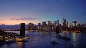 Brooklyn bridge and Manhattan after sunset stock video
