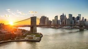 Brooklyn bridge and Manhattan at sunset. Panoramic view of Brooklyn bridge and Manhattan at sunset, New York City Royalty Free Stock Image