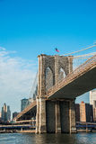 Brooklyn bridge in New York on bright summer day Stock Images
