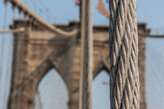Brooklyn Bridge at New York City with American flag Stock Images