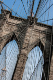 Brooklyn Bridge at New York City with American flag Stock Photo