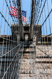 Brooklyn Bridge at New York City with American flag Stock Photography