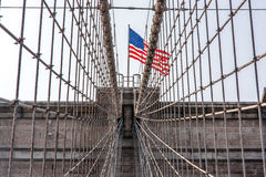 Brooklyn Bridge at New York City. Detail from the Brooklyn Bridge at New York City with American flag Royalty Free Stock Photos