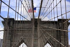 Brooklyn Bridge. In New York City and Flag of the United States Stock Photography