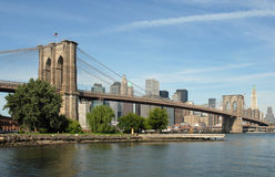 Brooklyn Bridge, New York City, USA. Picture of the iconic Brooklyn Bridge in New York City, taken from the Brooklyn shoreline looking across towards Manhattan Stock Images