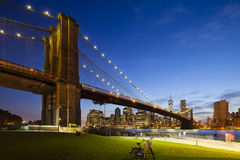 Brooklyn Bridge in New York At Night. The Brooklyn Bridge in front of the Manhattan skyline in New York City at night Stock Images