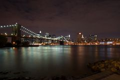 Brooklyn Bridge At Night. With Dowtown Manhattan in the background Royalty Free Stock Photo