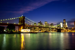 Brooklyn Bridge at Night. Night time long exposure featuring the Brooklyn Bridge, East River and the NYC Lower Manhattan Skyline Royalty Free Stock Photo