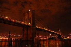 Brooklyn bridge by night. Brooklyn bridge by infernal night royalty free stock image