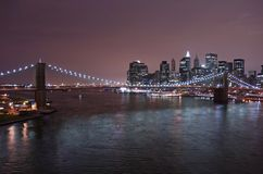 Brooklyn Bridge at night. Brooklyn Bridge and Manhattan skyline at night Stock Image