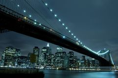 Brooklyn bridge at night. Manhattan skyline and Brooklyn bridge at night royalty free stock images