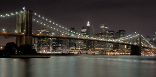 Brooklyn Bridge At Night. With Dowtown Manhattan in the background Royalty Free Stock Images