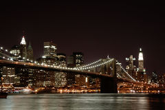 Brooklyn Bridge at Night. Nocturnal view from Brooklyn on the Brooklyn Bridge and the Lower East Side of Manhattan Stock Image