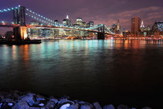 Brooklyn Bridge at Night. This is a shot of the Brooklyn Bridge. Manhattan is seen in the background. The image was shot just before the sunset (sun not seen in Stock Image