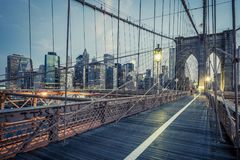 The Brooklyn Bridge by night. NYC Stock Images