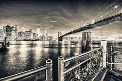 Brooklyn Bridge at night with Lower Manhattan skyline from Brook Royalty Free Stock Image