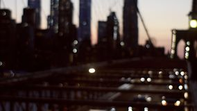 Brooklyn Bridge at night time with car traffic view from above of the busy roads of New York soft focus. Brooklyn Bridge at night time with car traffic view from stock footage
