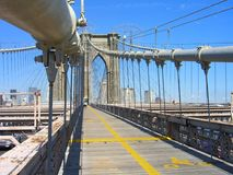 Brooklyn Bridge, NY City. Closeup of the Brooklyn Bridge in New York City, showing a walking, biking path and support cables in the foreground... a stone support Stock Photo