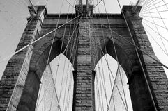 Brooklyn Bridge in NYC. Black and White Brooklyn Bridge Arcway and Cables stock photo