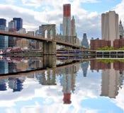 Brooklyn Bridge and NYC skyline. Brooklyn bridge and lower Manhattan reflected in East River Stock Image