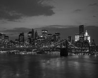 Brooklyn bridge and NYC skyline at sunset. In black and white Royalty Free Stock Image