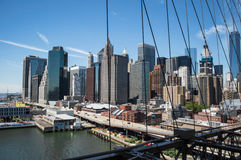 Brooklyn Bridge, One World Trade Center and Financial District: Summer in Manhattan. USA royalty free stock images