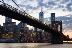 Brooklyn Bridge over East River at night Stock Photography