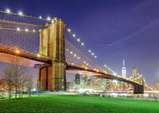 Brooklyn Bridge over East River at night in New York City Manhattan Stock Image