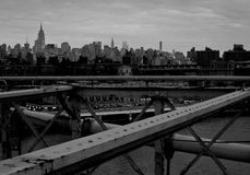 Brooklyn Bridge Overlooking Manhattan. Black and white photo of the Brooklyn Bridge and Manhattan Royalty Free Stock Images