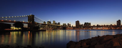 Brooklyn Bridge panorama. Panoramic view of Brooklyn Bridge and Manhattan skyline at dusk - New York City, USA (high-res panoramic shot stitched from 5 pictures Stock Photos