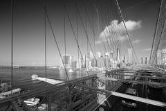 Brooklyn Bridge with passing cars and New York city skyline Stock Photo